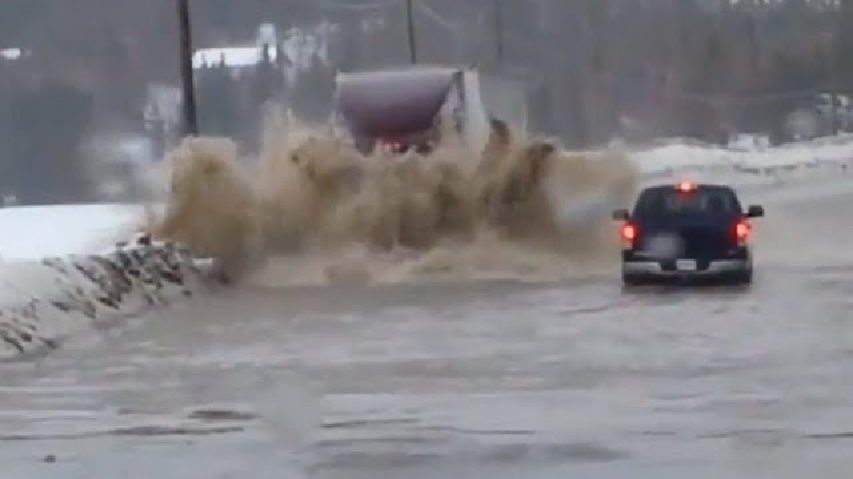 Semi-Truck-vs-Flood-–-No-Slowing-This-Guy-Down